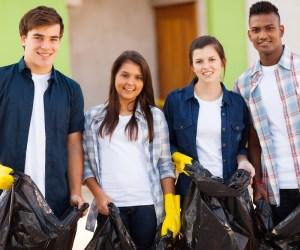 Teenage volunteers with garbage bags