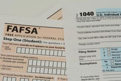 A FAFSA application and 1040 tax form