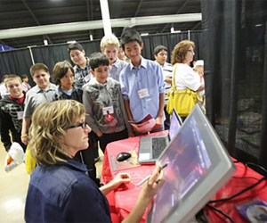 An image of students observing a STEM demonstration