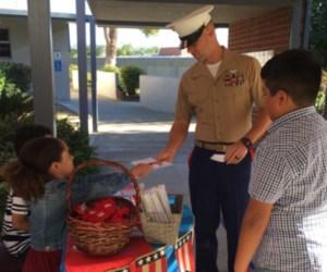 students greet U.S. Marine at school