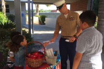 students greet U.S. Marine at school