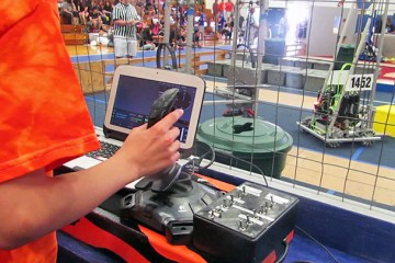 An image of a student controlling a robotics project