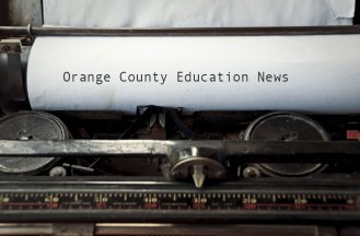 """An image of paper in a typewriter with the words """"Orange County Education News"""""""