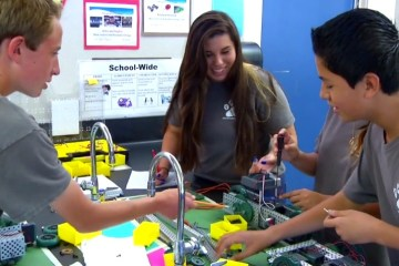 An image of students working on a robotics program in Tustin