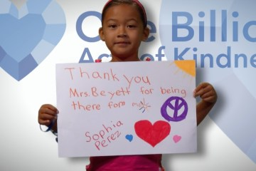 Student holding a thank-you sign