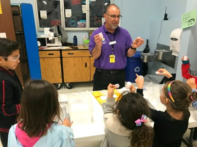 A teacher working with students in the classroom