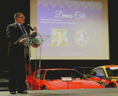Dennis Cole speaks onstage
