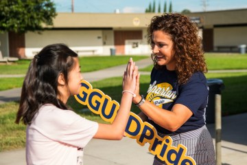 Assistant Principal gives a student a high-five