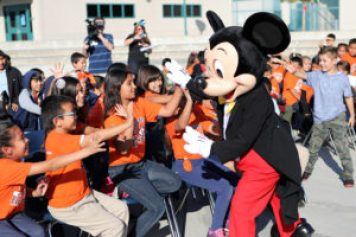 Mickey Mouse greets excited students