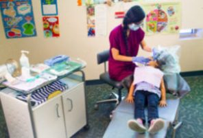dentist working on a child's mouth