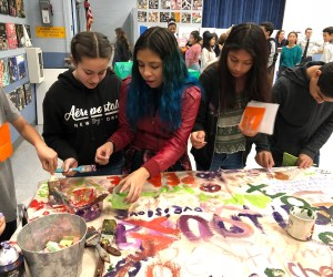 Four students painting