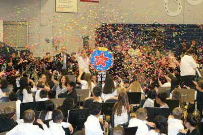 Students celebrate with confetti