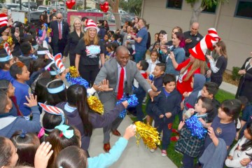State Superintendent Tony Thurmond high-fives children