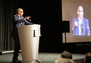 speaker at a podium