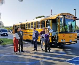 educators prepare to board school bus