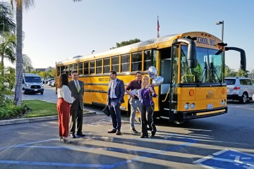 educators prepare to board school bus