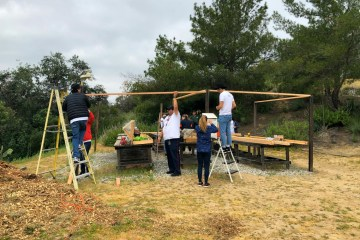 Volunteers building a structure