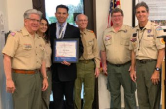 oc superintendent poses for photo with boy scout leaders