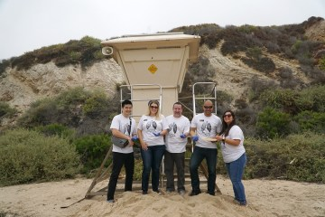 OCDE staff at a beach cleanup event