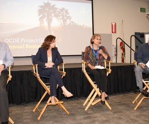 a panel speaks to an audience