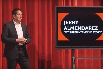 superintendent Jerry Almendarez standing on stage