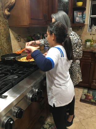 Girl helps her mother cook