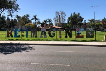 "Artwork spells out ""RE: IMAGINE"""