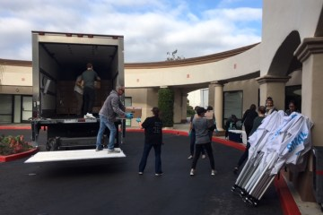 Workers unload groceries for families