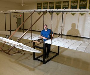 Teacher with Wright brothers glider replica