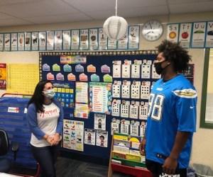 Teacher Maria Martinez and Isaac Rochell