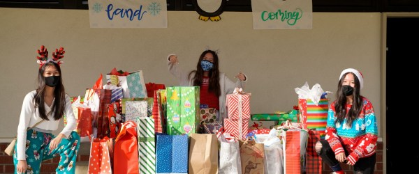 Three students with presents