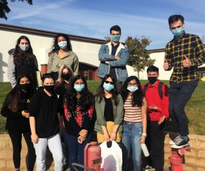 Team of students wearing masks