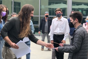 IUSD students and CEO Dan Price