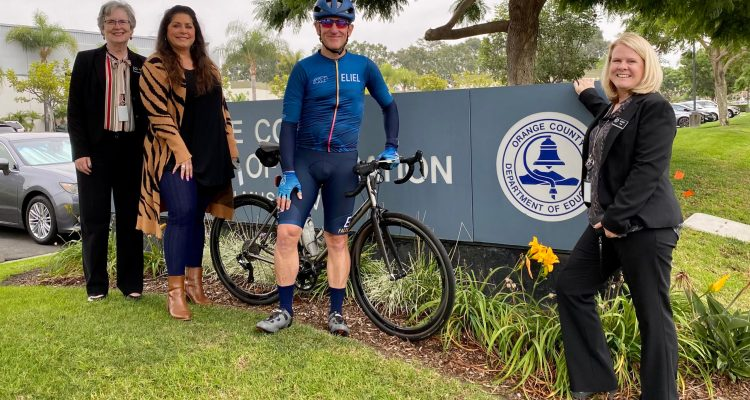 Brian Dozer with bike and OCDE staff