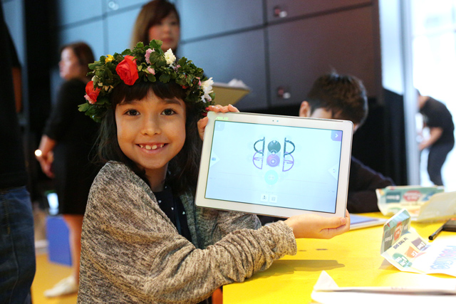 "A participating child displays her ""Mobilmo""."