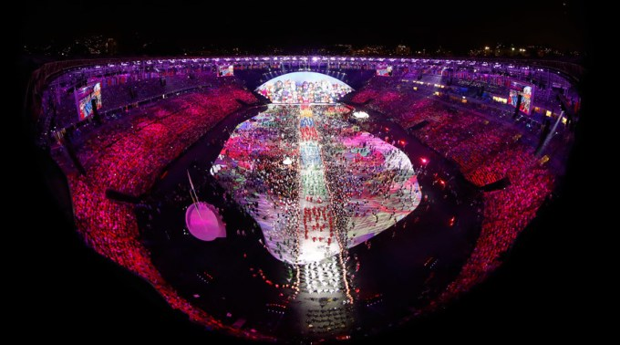 Performers take part in the opening ceremony. REUTERS/PawelKopczynski