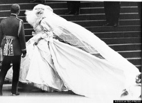 Lady Diana Spencer in her wedding gown on the steps of St. Paul's Cathedral in London on her way to the wedding ceremony, July 29, 1981. The person at left is unidentified. (AP Photo/Rob Taggart BIPNA Pool)