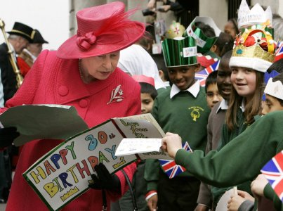 Britain's Queen Elizabeth II meets school children during a walkabout to celebrate her 80th birthday in Windsor.