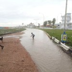 High tide rushes over Seawalls; areas flooded