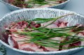 boned out lamb, garlic scapes and rosemary