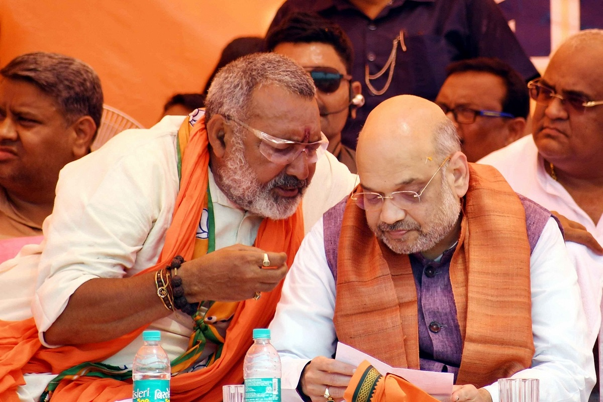 Begusarai: BJP chief Amit Shah in a conversation with Union Minister and the party's Lok Sabha candidate from Begusarai, Giriraj Singh during a public rally in Bihar's Begusarai, on April 24, 2019. (Photo: IANS)