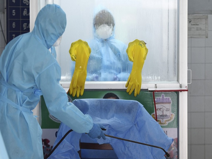 A medical technician disinfects the floor of a COVID-19 testing and sample collection centre during a government-imposed nationwide lockdown as a preventive measure against the COVID-19 coronavirus in Chennai on April 14, 2020. (Photo by Arun SANKAR / AFP)