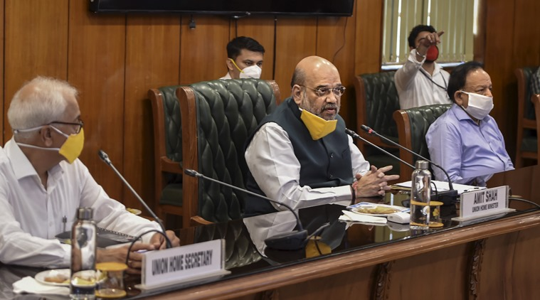 New Delhi: Union Home Minister Amit Shah with Health Minister Harsh Vardhan (2nd R) and senior officers holds a meeting to discuss the COVID-19 situation in Delhi, at North Block in New Delhi, Sunday, June 14, 2020. The meeting comes in the wake of increasing number of coronavirus cases in Delhi, where the tally has reached nearly 39,000 cases and the death toll rose to over 1,200. (PTI Photo/ Shahbaz Khan) (PTI14-06-2020_000037B)