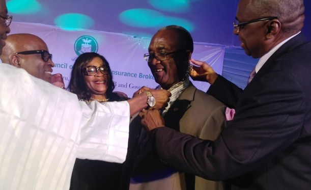 Former Presidents of the Nigerian Council Of Registered Insurance Brokers (NCRIB) taking chain of office off Mr. Ayodapo Shoderu, out-going President of the Council on Thursday in Lagos