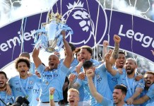 Ruthless Manchester City survive scare to retain EPL title