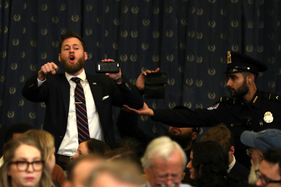 Infowars host and pro-Trump protester disrupts hearing; doesn't understand what treason means
