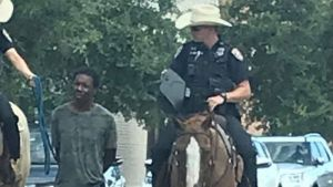 Black man led on rope by Texas police on horseback sues for $1m