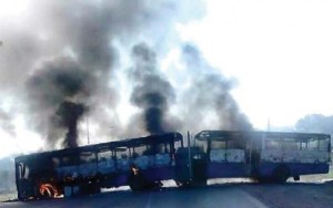 Buses torched by protesters.