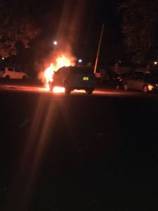 Kabwila's car in flames.