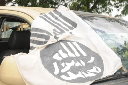 Flag of he terrorists on one of the captured vehicle by Nigerian troops in Konduga